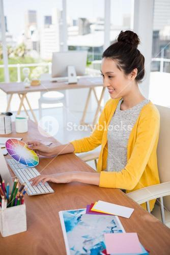 A businesswoman is working on her computer