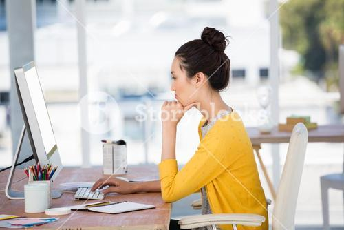 Side view of a working girl in her office