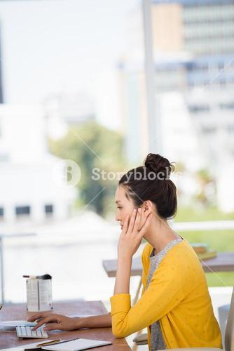 Side view of a working girl