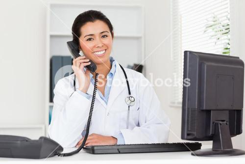 Lovely woman doctor on the phone while sitting