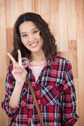 Smiling hipster showing peace