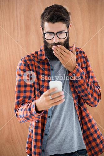 Shocked hipster with smartphone