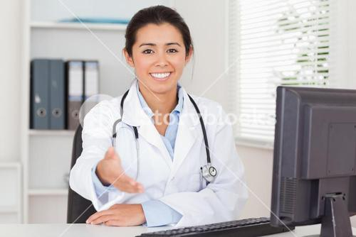 Pretty female doctor inviting somebody to seat while looking at the camera