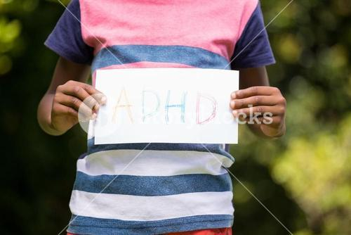 Boy showing a poster with ADHD