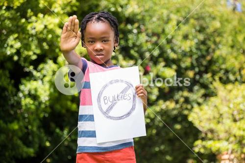 Boy saying stop with hand and paper