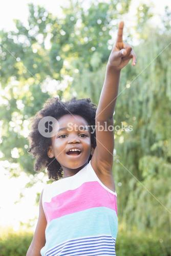 Smiling child with hand up