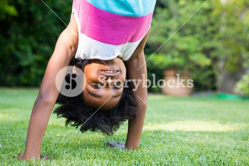 A kid doing a headstand