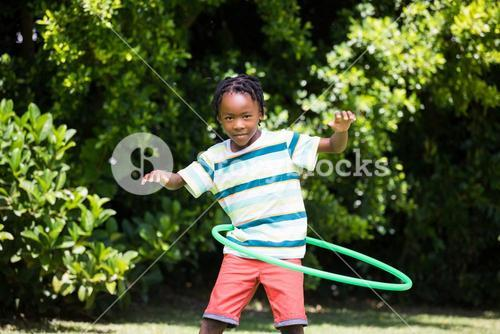 A kid playing with a hoop