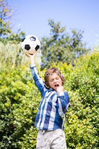 Portrait of cute boy celebrating his soccer victory
