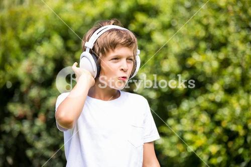 Child listening music with headphone