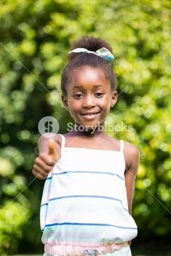 Mixed-race girl throwing up thumb
