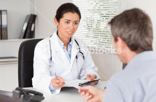 Patient giving his beautiful woman doctor a piece of paper
