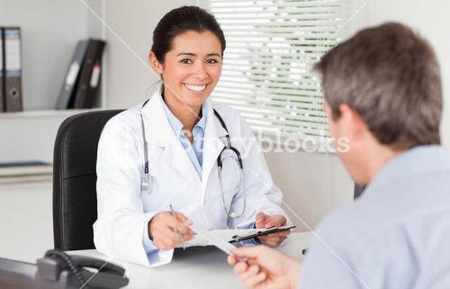 Patient giving his attractive woman doctor a piece of paper