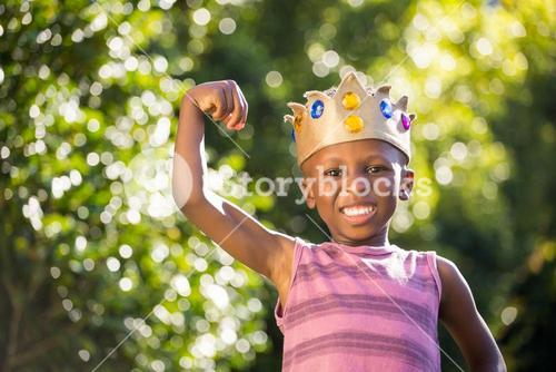 Smiling boy with a king crown