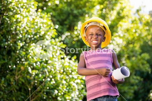 Boy is wearing an hardhat
