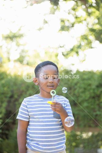 Portrait of boy making bubbles with bubble wand