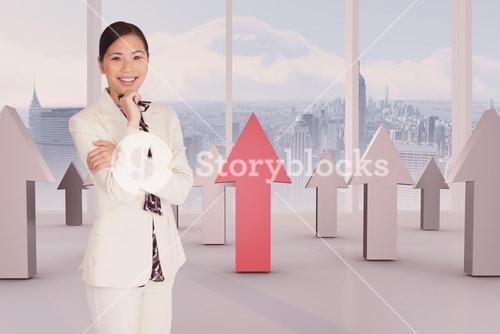 Composite image of delighted businesswoman shouting through a megaphone