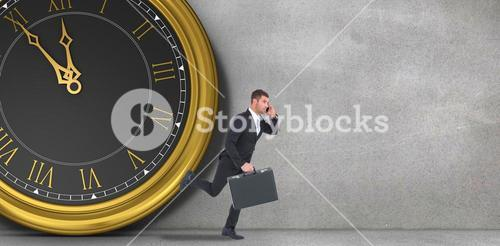 Composite image of running businessman