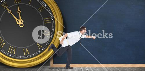 Geeky young businessman running late