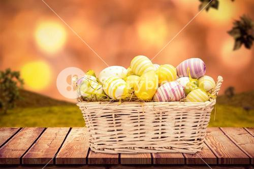 Composite image of easter eggs in basket