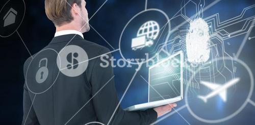 Composite image of businessman looking up holding laptop