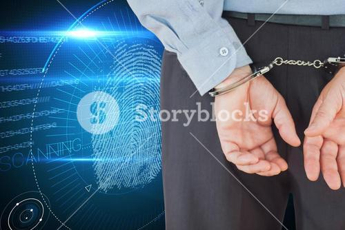 Composite image of businessman in formals with handcuffs