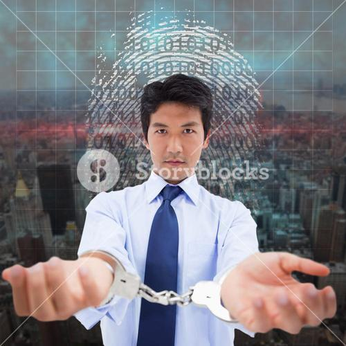 Composite image of businessman with handcuffs