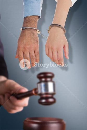 Composite image of closeup of handcuffed business people