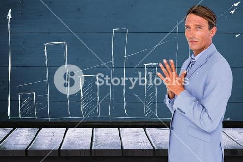 Composite image of portrait of confident businessman with hands clasped