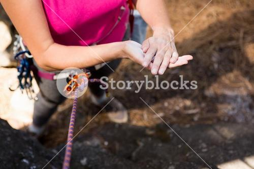 Woman getting ready to rock climbing