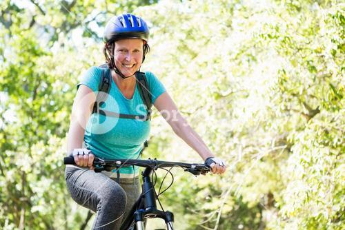 Mature woman riding bike