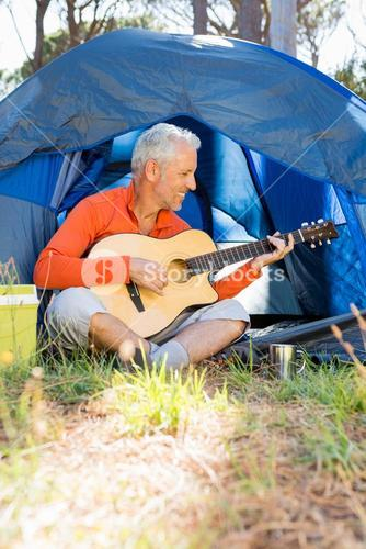 Mature man playing guitar