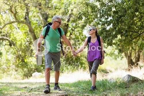 Couple hiking and holding hands each other