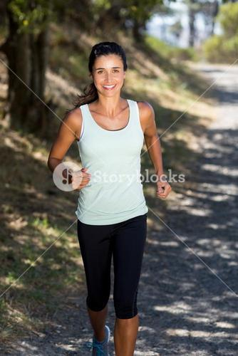 Woman smiling and running