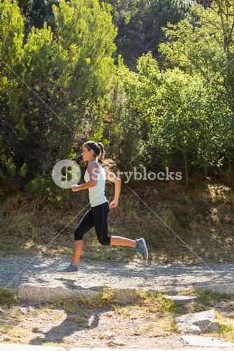 Profile view of woman jogging