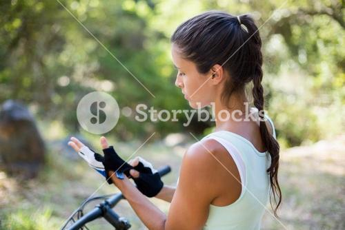 Concentrated woman preparing ride bike