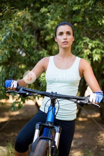 Concentrated woman posing with her bike