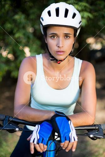 Woman unsmiling posing with her bike