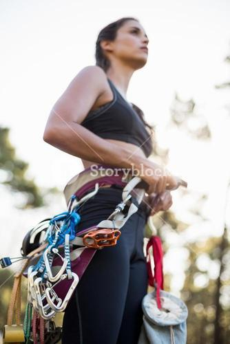 Close up of climbing equipment on a woman