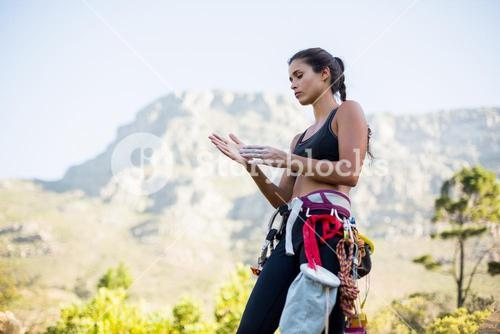 Woman preparing rock climbing