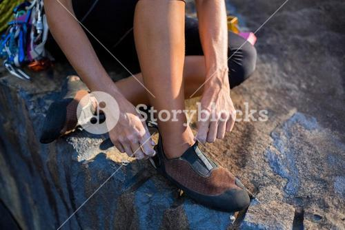 Close up of woman preparing rock climbing