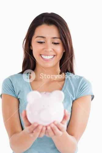 Good looking woman posing with a piggy bank