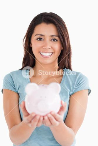 Lovely woman posing with a piggy bank