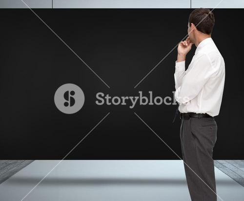 Composite image of thoughtful classy businessman looking away