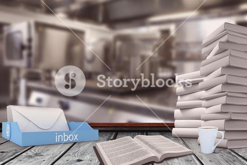 Composite image of an inbox beside books