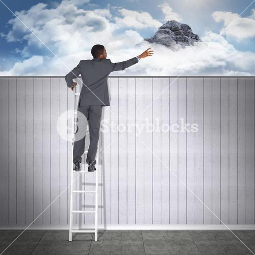 Composite image of businessman looking on a ladder