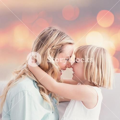 Composite image of mother and daughter rubbing noses on sofa