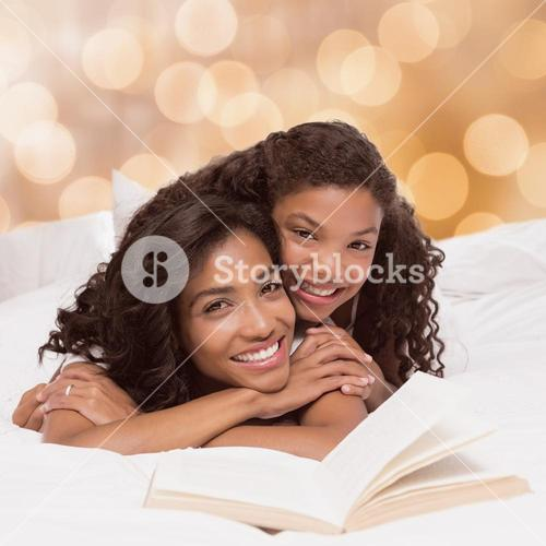 Composite image of mother and daughter reading book together on bed