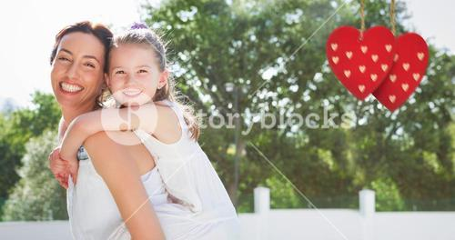 Composite image of Mother and daughter holding each other