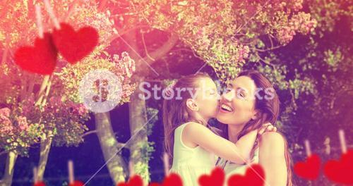 Composite image of mother and daughter holding each other in garden
